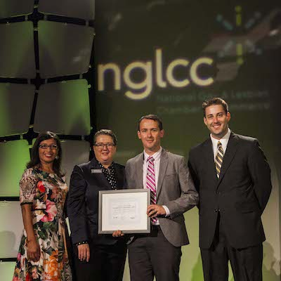 Chamber Vice President Harry Young (third from left) and Board Member Cory Messinger (fourth from left) accept the 2014 National Chamber Excellence Community Impact Award from Sam McClure (second from left), NGLCC Vice President of Affiliate Relations and External Affairs. (Photo by NGLCC)